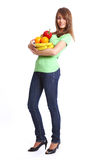 Young smiling woman with fruits Stock Photography