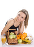 Young smiling woman with fruits Stock Images