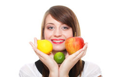 Young smiling woman with fruits and vegetables white background Royalty Free Stock Image