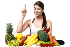 Young smiling woman with fruits and vegetables Stock Images