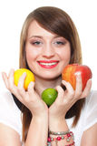 Young smiling woman with fruits and vegetables white background Royalty Free Stock Photos