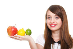 Young smiling woman with fruits and vegetables white background Stock Photography