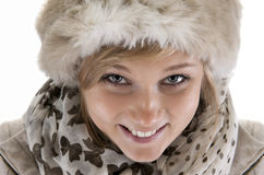 Young smiling woman with fur hat. On white Stock Photography