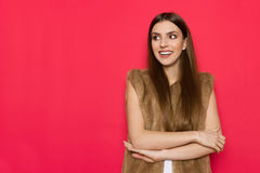 Young Smiling Woman In Fur Waistcoat Is Looking Away Stock Images