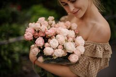 Free Young Smiling Woman Gently Holds Bouquet Of Pastel Pink Peony Flowers In Buds Stock Image - 184089701