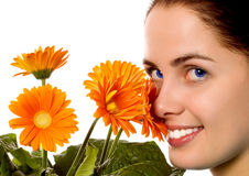 Young smiling woman with gerber flowers. (isolated on white royalty free stock photography