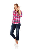 Young smiling woman gesturing perfect sign Royalty Free Stock Image