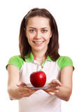 Young smiling woman give red apple on plate Stock Photos
