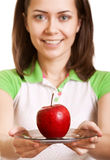 Young smiling woman give red apple on plate Stock Image