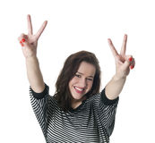 Young smiling woman giving peace sign. Laughing young woman showing victory-sign with two hands Stock Images