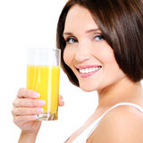 Young smiling woman with glass of orange juice Stock Image