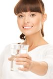 Young smiling woman with glass of water Stock Photos