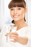 Young smiling woman with glass of water Stock Image