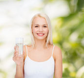 Young smiling woman with glass of water Royalty Free Stock Photo