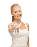 Young smiling woman with glass of water Stock Photography