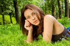 Young smiling woman on the grass Stock Image