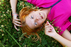 Young smiling woman on the grass Stock Photography