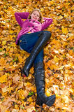Young smiling woman on the ground Royalty Free Stock Image