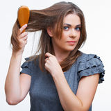 Young smiling woman hair dress makes . Royalty Free Stock Photo