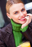 Young smiling woman with hand under chin Stock Images