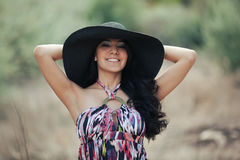 Young smiling woman with hat Stock Photos