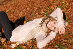 Young smiling woman with hat and scarf outdoor in autumn royalty free stock photo