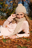 Young smiling woman with hat and scarf outdoor in autumn Stock Images