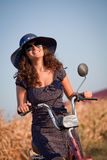 Young smiling woman with hat and sunglasses. Royalty Free Stock Photo