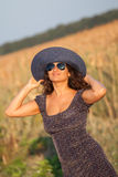 Young smiling woman with hat and sunglasses. Royalty Free Stock Photos