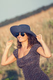 Young smiling woman with hat and sunglasses. Royalty Free Stock Images
