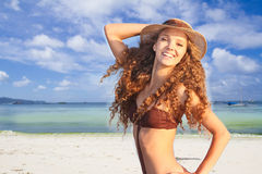 Young smiling woman in hat on tropical sea background Stock Photo