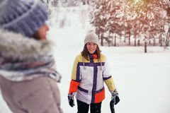 Young smiling woman having fun on snow hill Stock Images