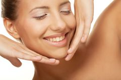 Young smiling woman with healthy skin Royalty Free Stock Photos