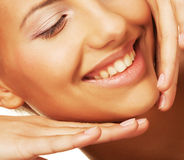 Young smiling woman with healthy skin Stock Photography