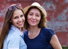 Young smiling woman with her teen daughter Royalty Free Stock Image