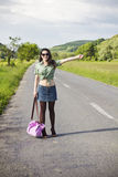 Young smiling woman hitchhiking Stock Photo