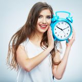 Young smiling woman hold watch. Beautiful smiling girl portrait. Young smiling woman hold blue watch. Beautiful smiling girl portrait. Isolated studio background stock photo