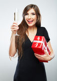 Young smiling woman hold christmas red gift box. Royalty Free Stock Image