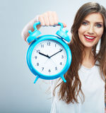 Young smiling woman hold watch. Beautiful smiling girl portrait Royalty Free Stock Photos