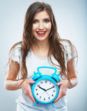 Young smiling woman hold watch. Beautiful smiling girl portrait Stock Photo