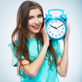 Young smiling woman hold watch. Beautiful smiling girl portrait Royalty Free Stock Photography