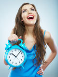 Young smiling woman hold watch. Beautiful smiling girl portrait Royalty Free Stock Image