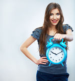 Young smiling woman hold watch. Beautiful smiling girl portrait Royalty Free Stock Photo