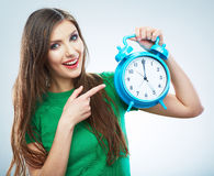 Young smiling woman hold watch. Beautiful smiling girl portrait Stock Images