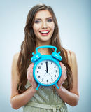 Young smiling woman hold watch. Beautiful smiling girl portrait Royalty Free Stock Images