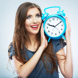 Young smiling woman hold watch. Beautiful smiling girl portrait Stock Photography