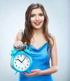Young smiling woman hold watch. Beautiful smiling  Stock Photo
