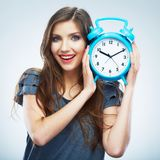 Young smiling woman hold watch. Beautiful smiling girl portrait. Isolated studio background female model royalty free stock photos