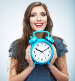 Young smiling woman hold watch. Beautiful smiling girl portrait. Isolated studio background female model stock images