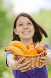 Young smiling woman holding basket Stock Photos